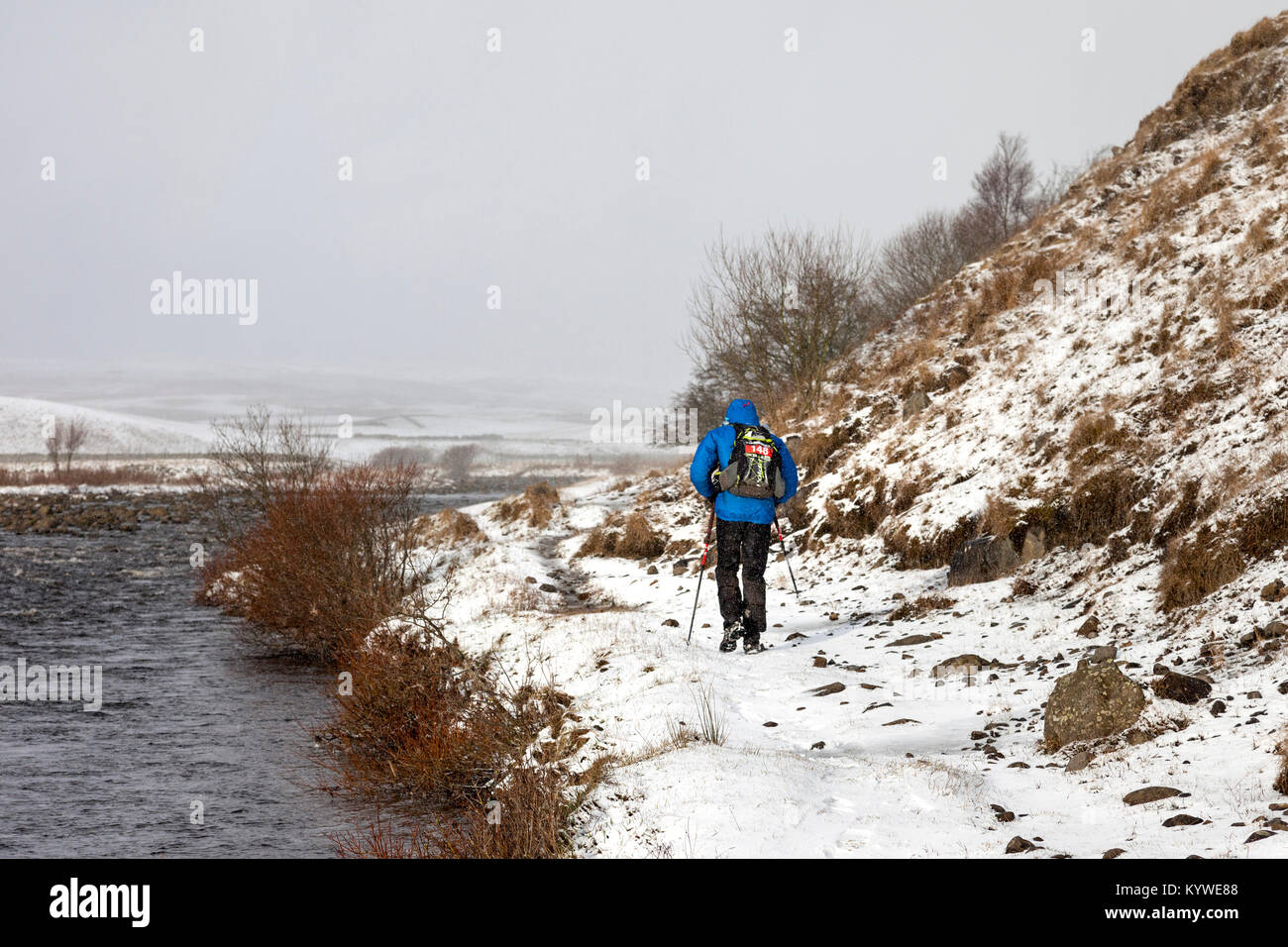 Upper Teesdale, County Durham UK. Tuesday 16th January 2018. Competitor 148 Simon Gfeller faced some tough winter - Stock Image