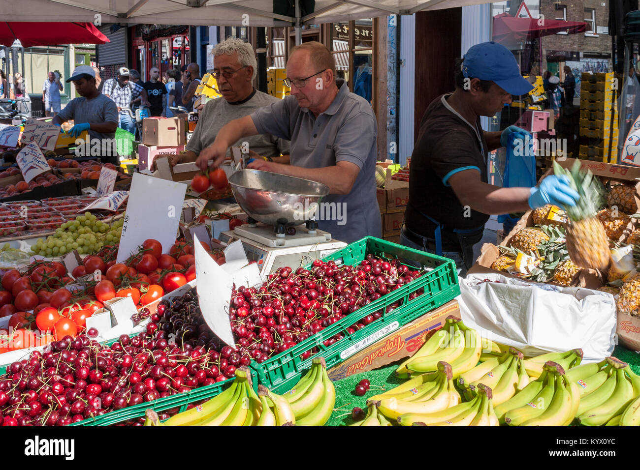 Brick Lane Market market traders on a fruit stall. Brick Lane, East London, England, GB, UK. Stock Photo
