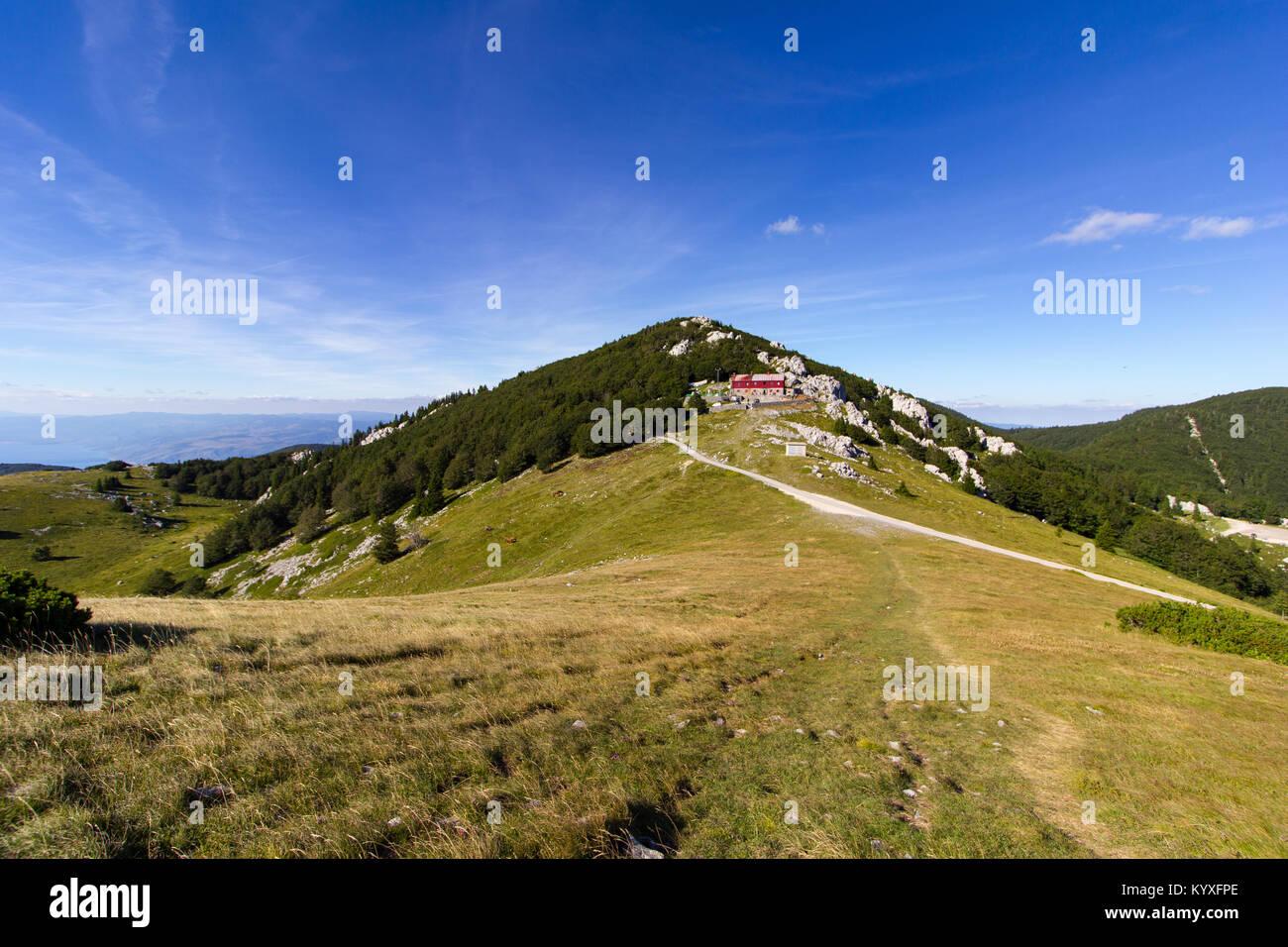 Mountain hut at Zavizan viewed from the nearest peak - Northern Velebit National Park, Croatia -  Aug 2016 Stock Photo