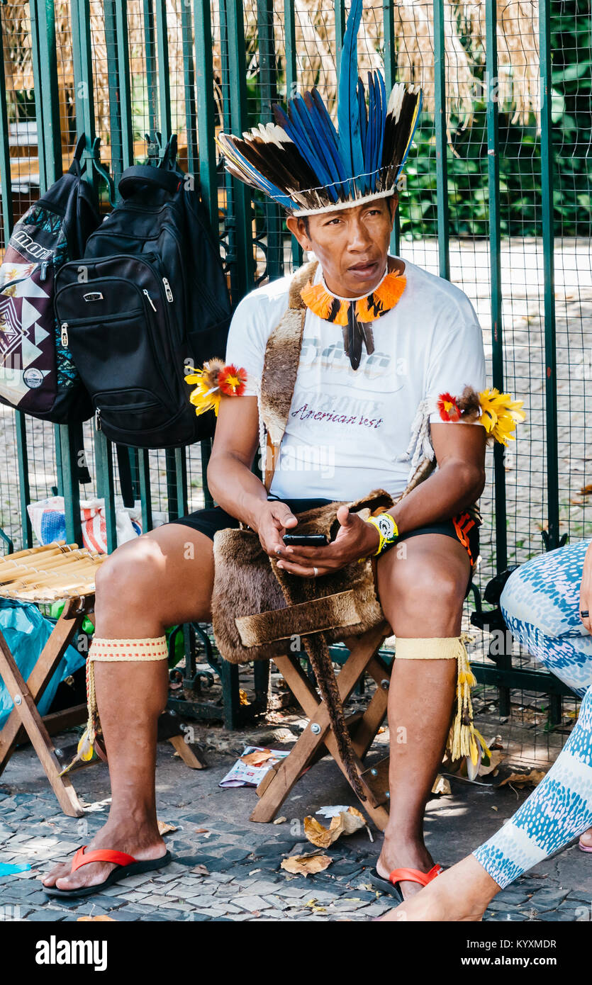 brazilian-indigenous-man-on-his-cell-phone-KYXMDR.jpg
