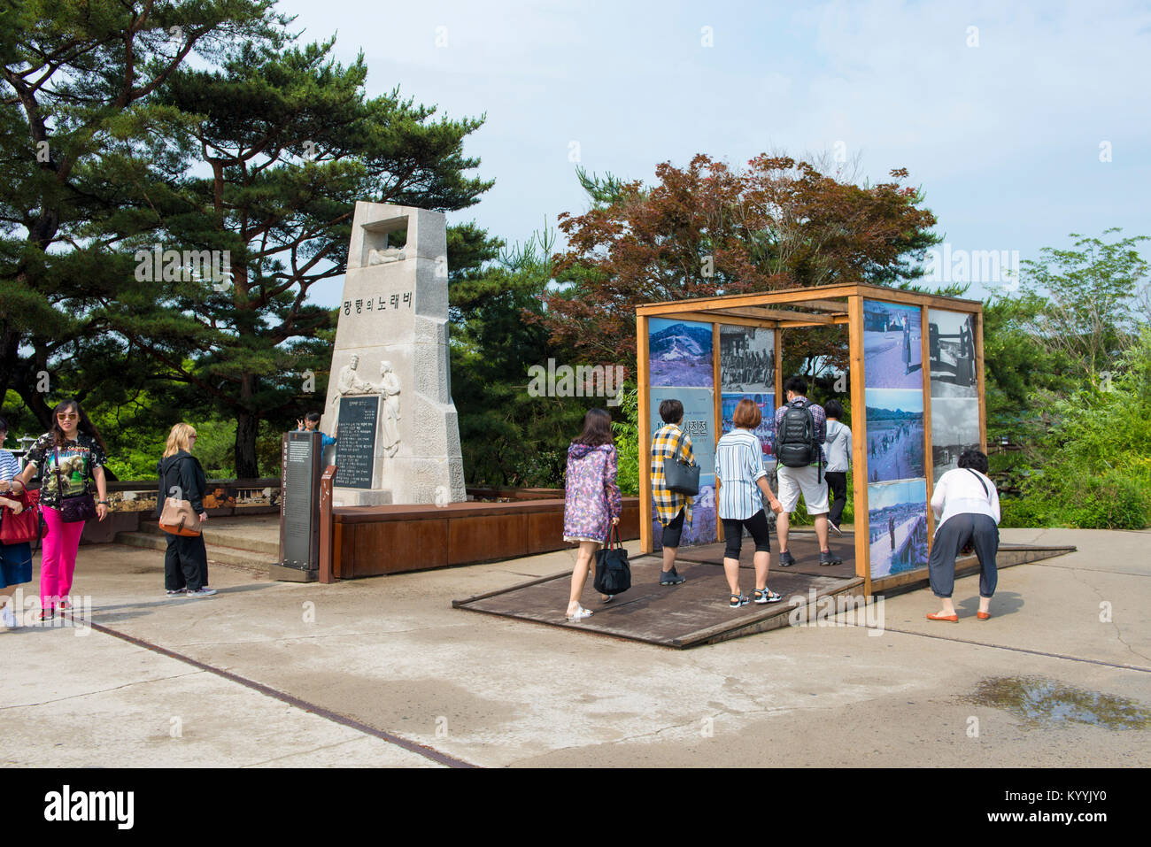 Tourists looking at exhibits from the Korean War at the DMZ in South Korea - Stock Image