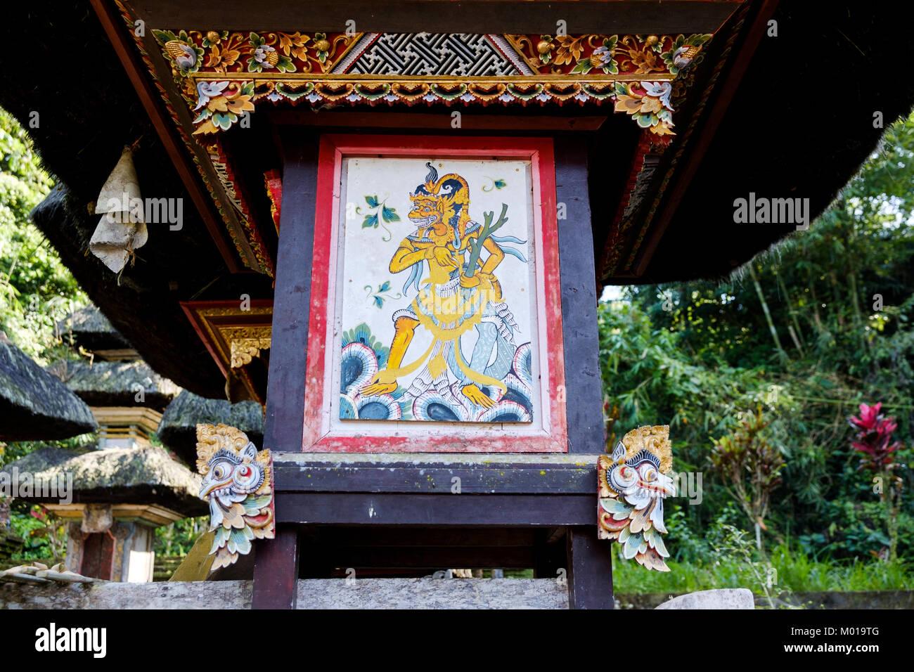 Carved and painted wood artwork at Gunung Kawi Sebatu Temple ('pura'), Bali, Indonesia. - Stock Image