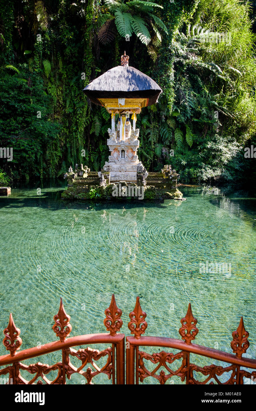 Shrine inside pond at Pura Gunung Kawi Sebatu, a Hindu temple in Bali, Indonesia. - Stock Image