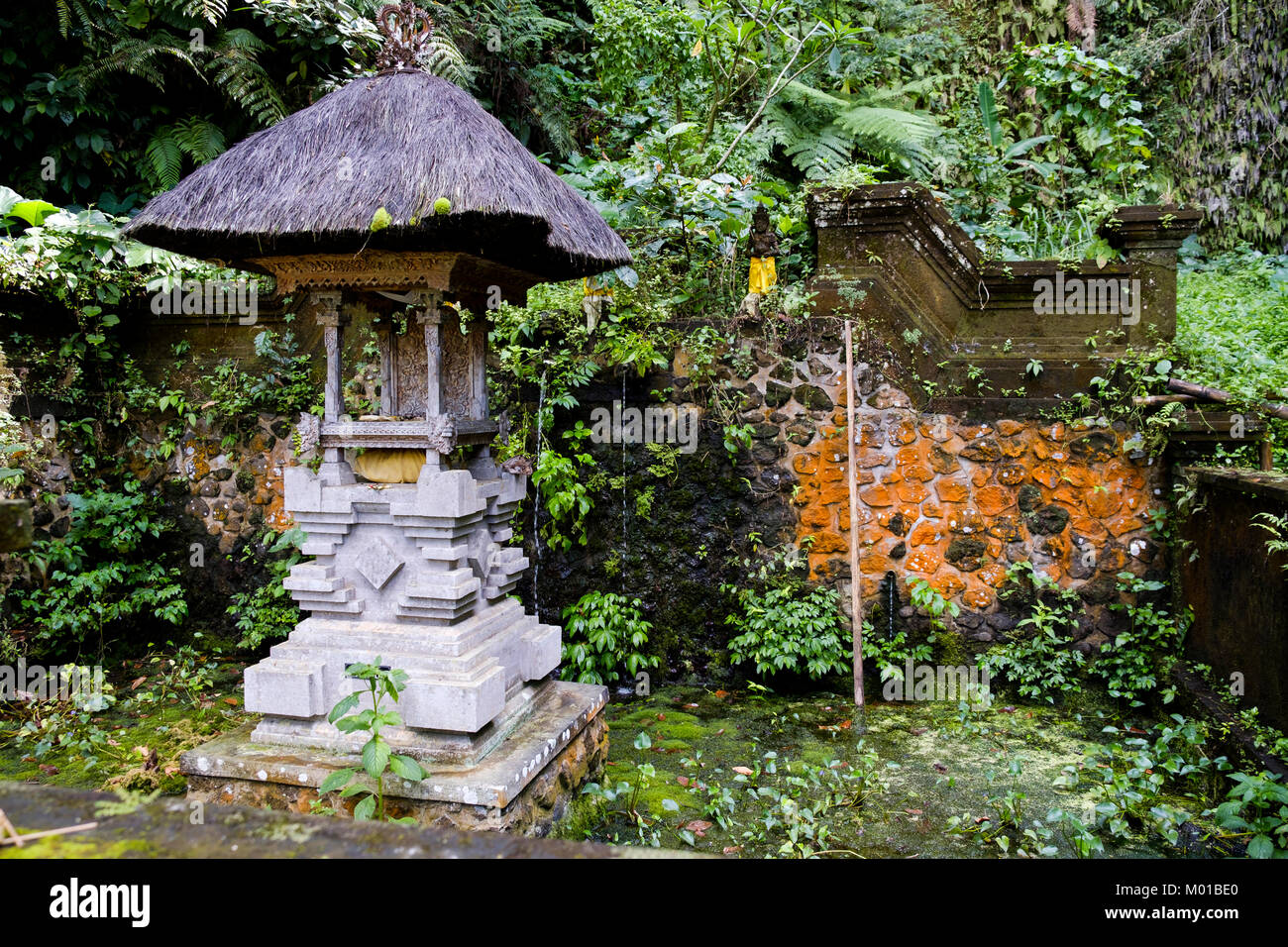 A small thatched-roof shrine within the Gunung Kawi complex in Tampaksiring, Bali, Indonesia. - Stock Image
