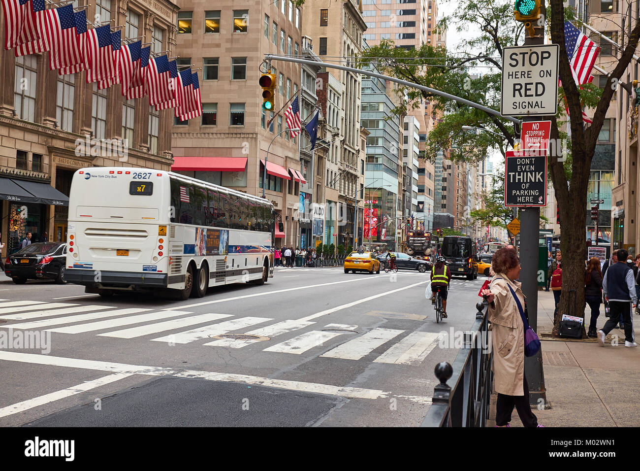 NEW YORK CITY - SEPTEMBER 29, 2016: 5th Avenue with many signs, one saying 'Don't even think of parking - Stock Image