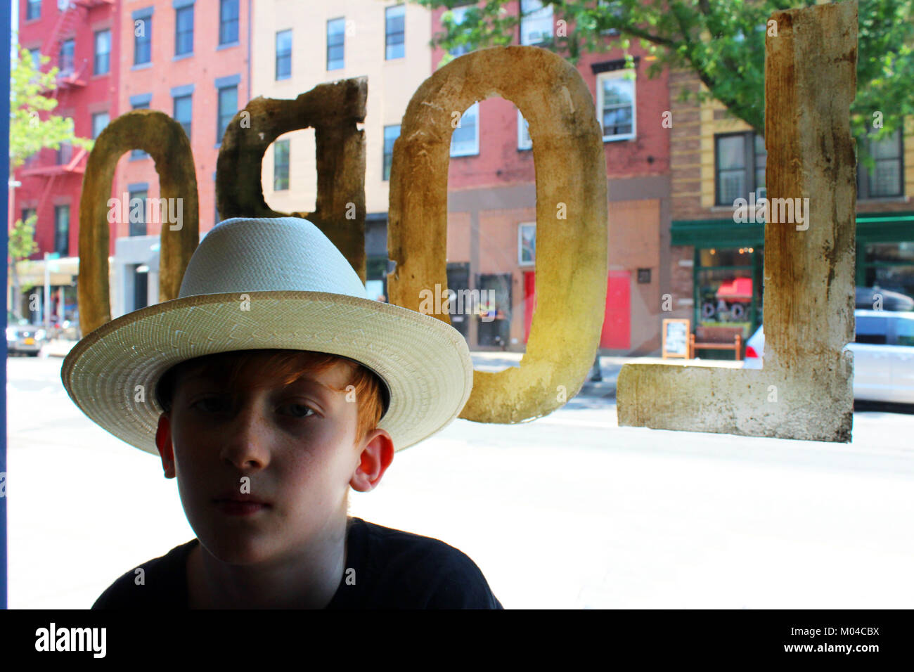 red haired boy wearing stetson open road cowboy hat in lobo bar brooklyn  new york 89c4f4b4eb4