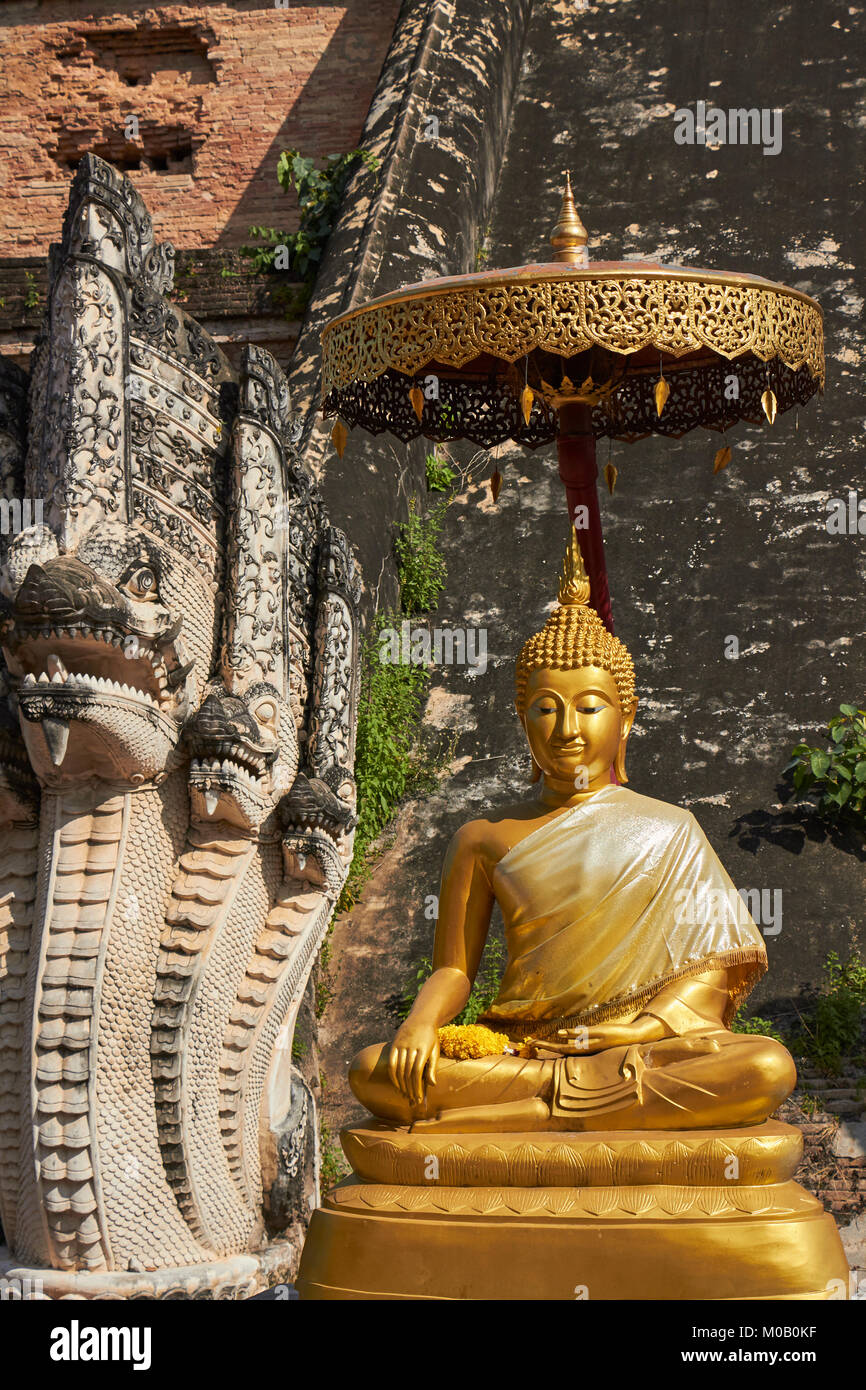 Seated Buddha figure, Wat Chedi Luang temple and grounds, Chiang Mai, Thailand - Stock Image