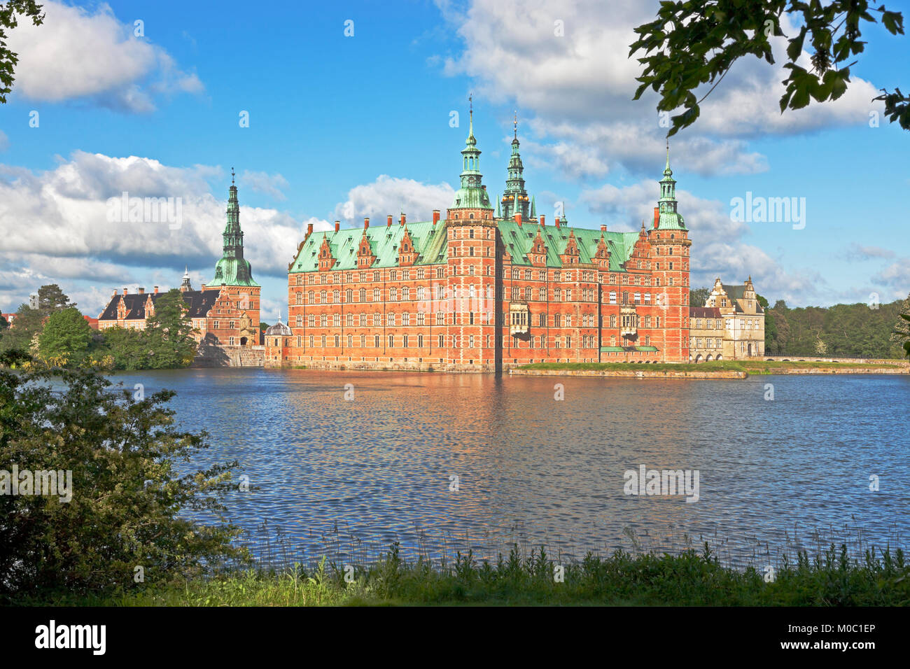 The Frederiksborg Castle in Dutch Renaissance style in Hillerød near Copenhagen, Denmark, in bright summer - Stock Image