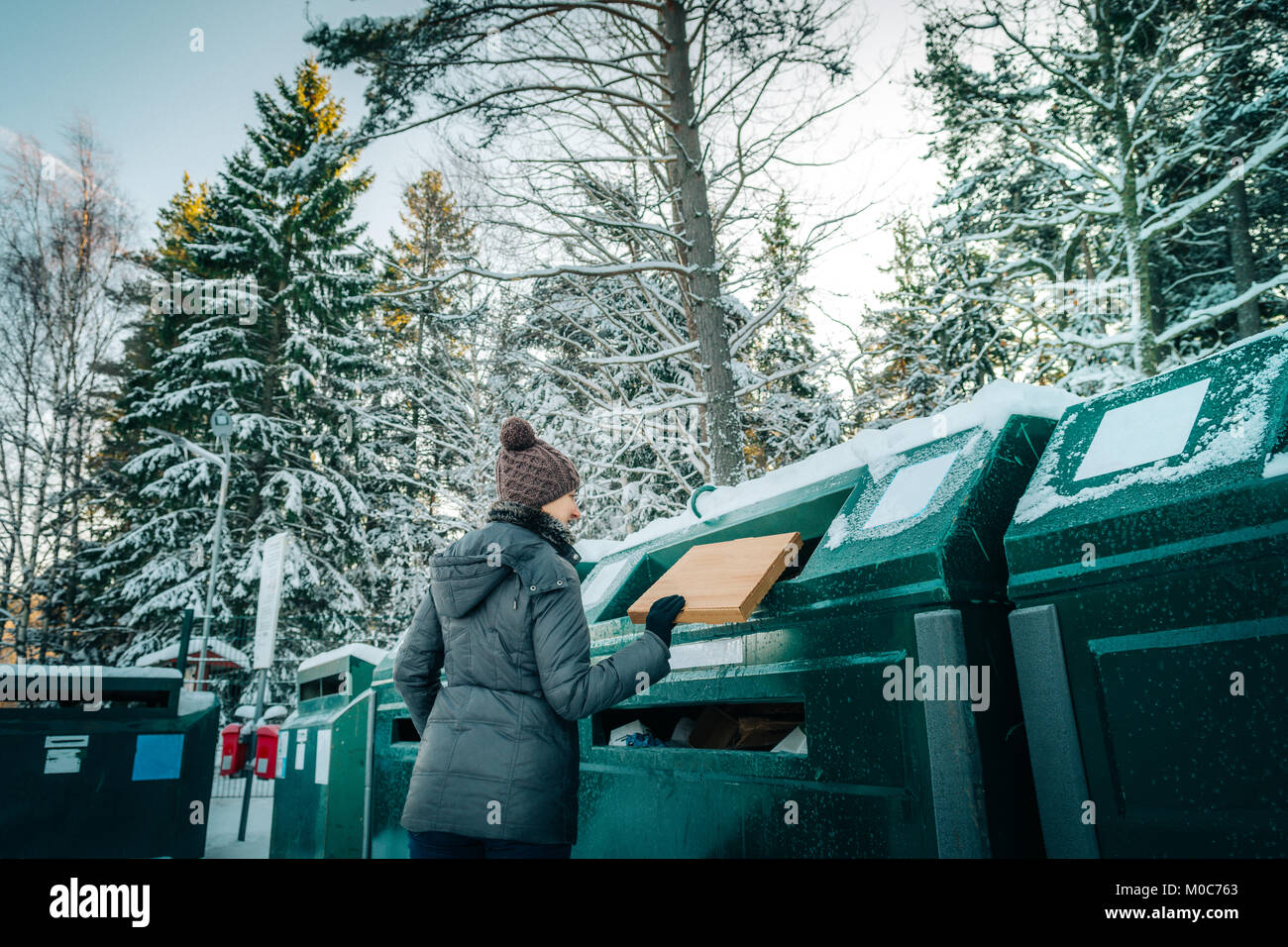 Woman recycling at waste management depo - Stock Image
