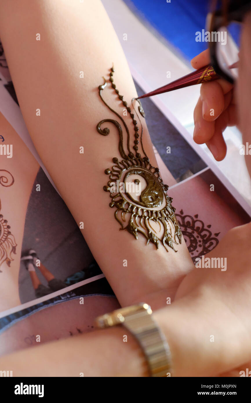 Artist Drawing Henna Pattern On Woman Hand A Tradition Art Of