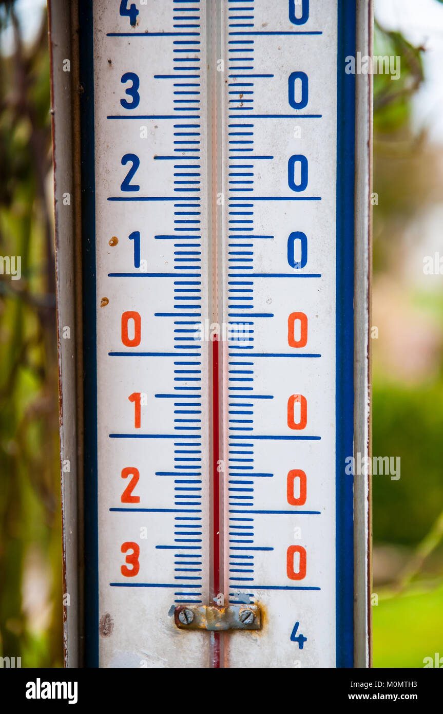 old outdoor thermometer detail view of +2 degrees C. - Stock Image