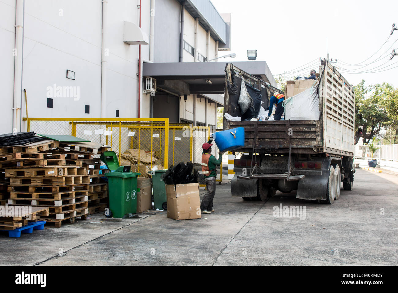 Waste Management, The garbage truck with worker - Stock Image