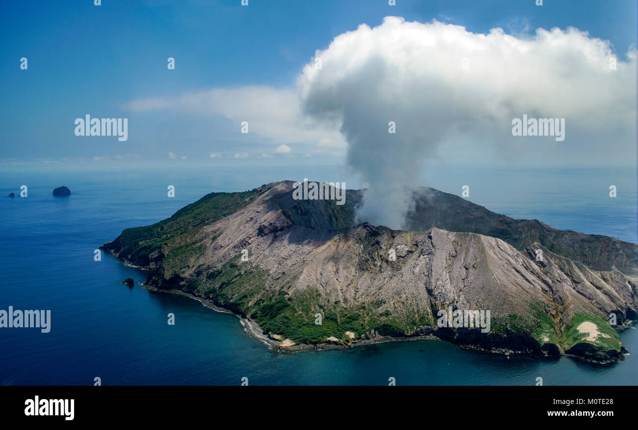 Approaching White Island / Whakaari volcano by helicopter. Bay off Plenty, North Island, New Zealand. Whakaarian - Stock Image