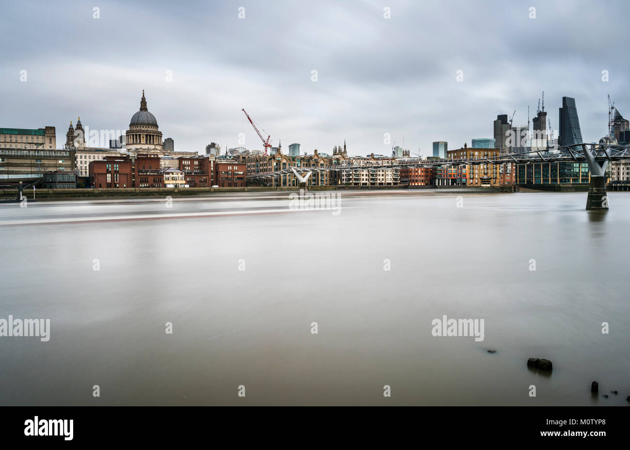 St Paul's Cathedral and the Millennium Bridge, London, UK - Stock Image