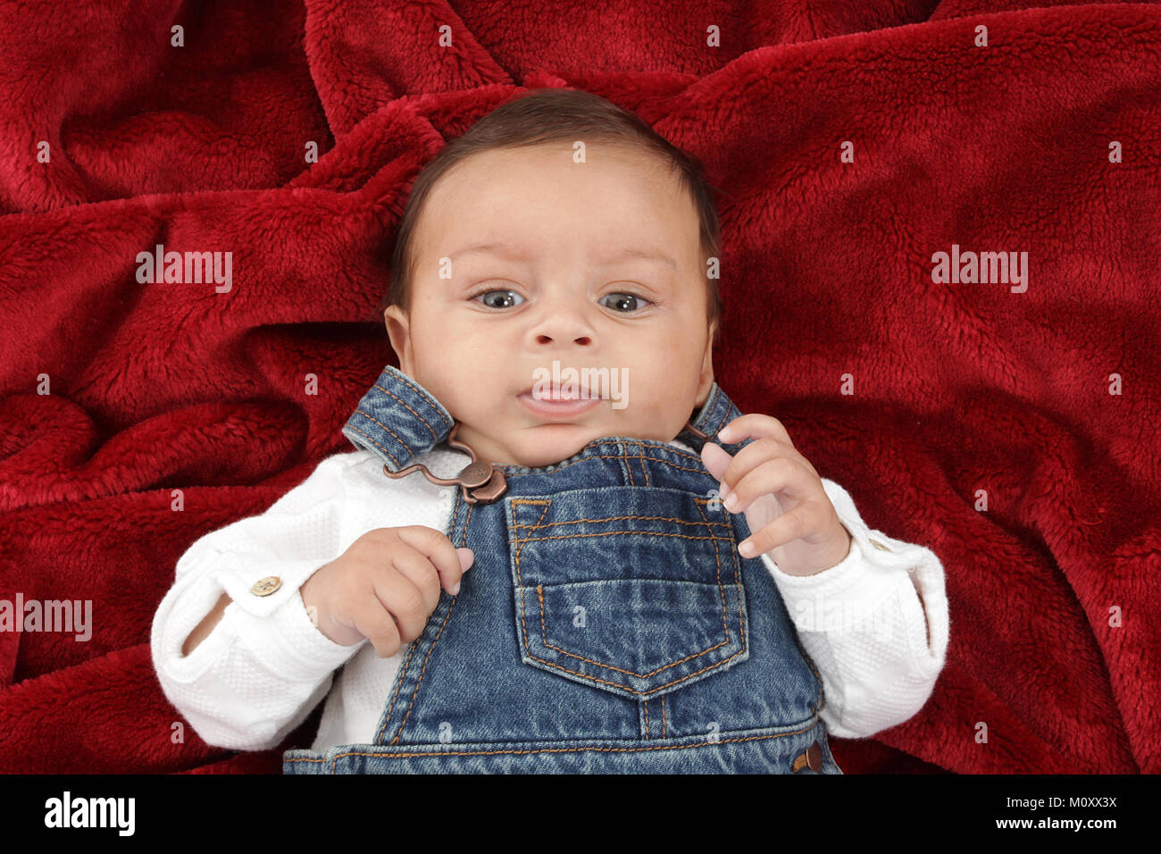 45eca7a8c6c 3 month old mixed race baby boy playing on a rug Stock Photo ...