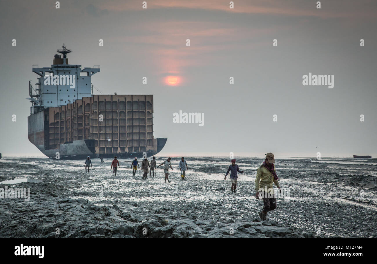 workers leaving after a days labor at a ship braking yard in Chittagong, Bangladesh Stock Photo