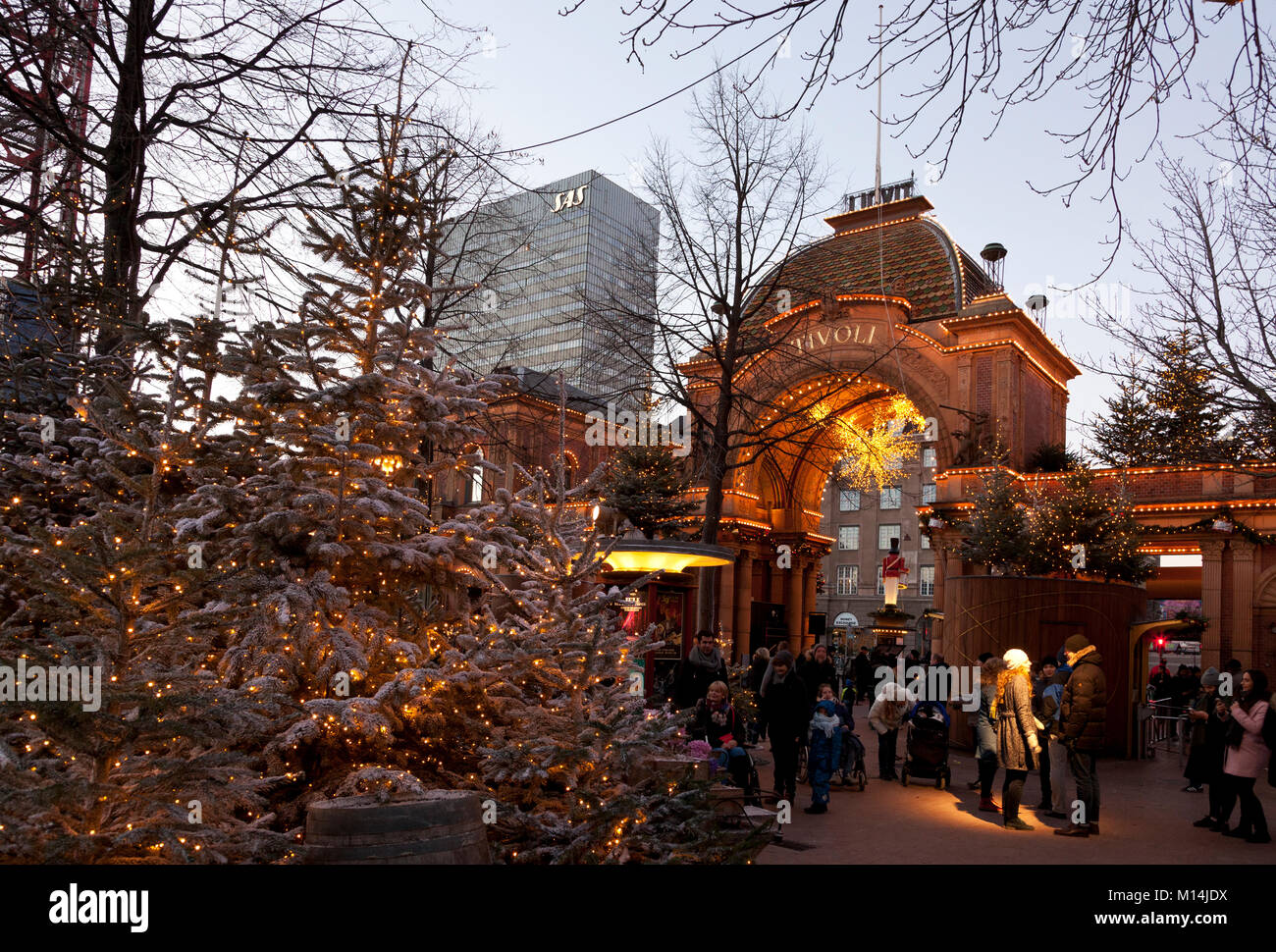 View out of the main entrance of the Tivoli Gardens in Copenhagen at dusk during Christmas market opening. The SAS - Stock Image