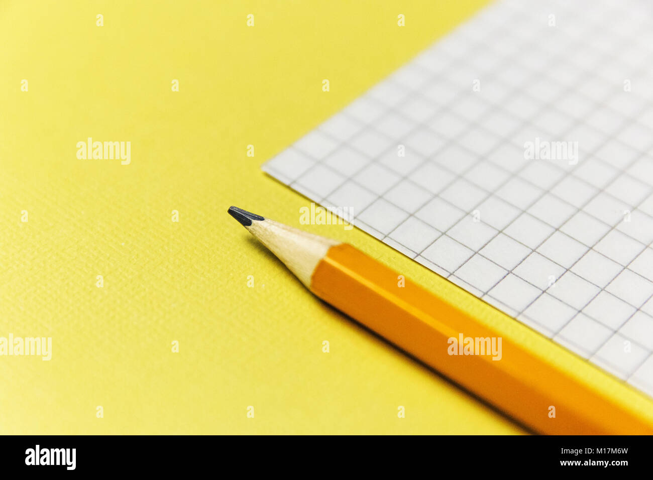 notebook and a green pencil on blue background office theme stock