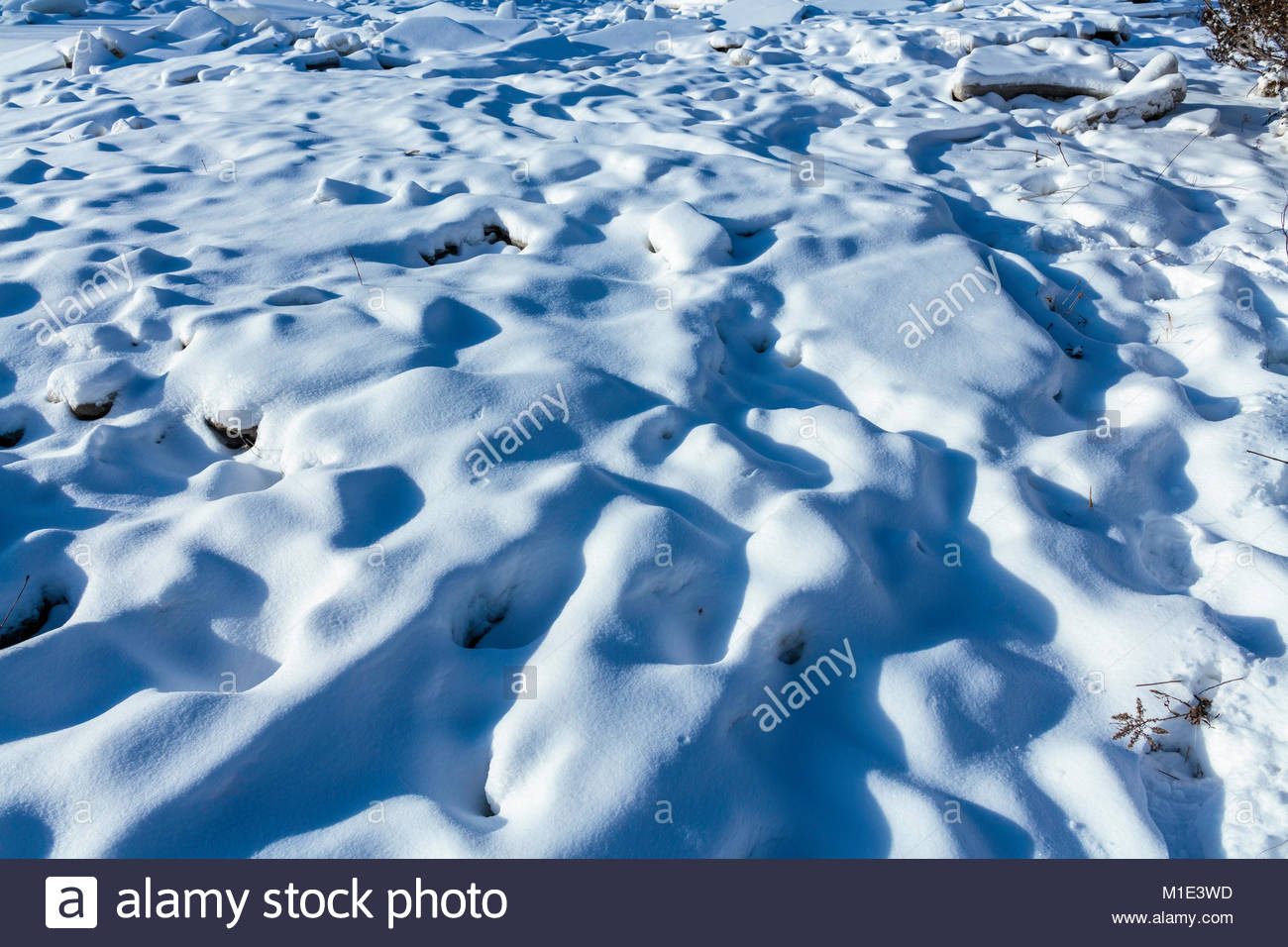 shadows-on-snow-covered-blocks-of-ice-in