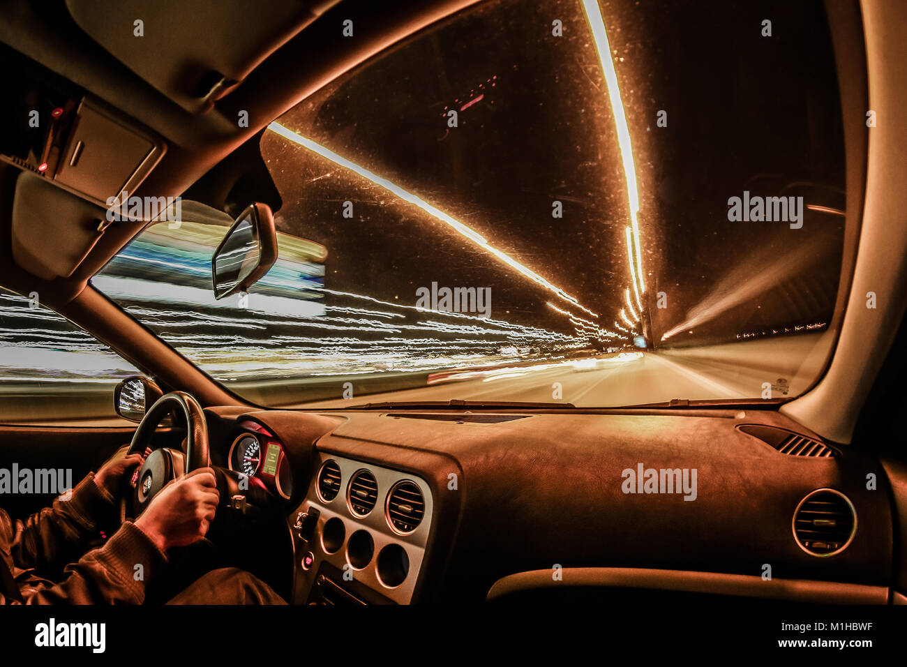 driving through the night stock photos driving through the night stock images alamy. Black Bedroom Furniture Sets. Home Design Ideas