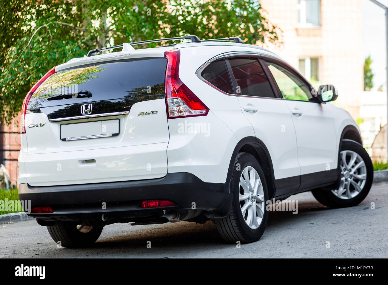 Novosibirsk, Russia -  June 18, 2017: white Honda CRV , side back. Photography of a urban crossover in the street - Stock Image