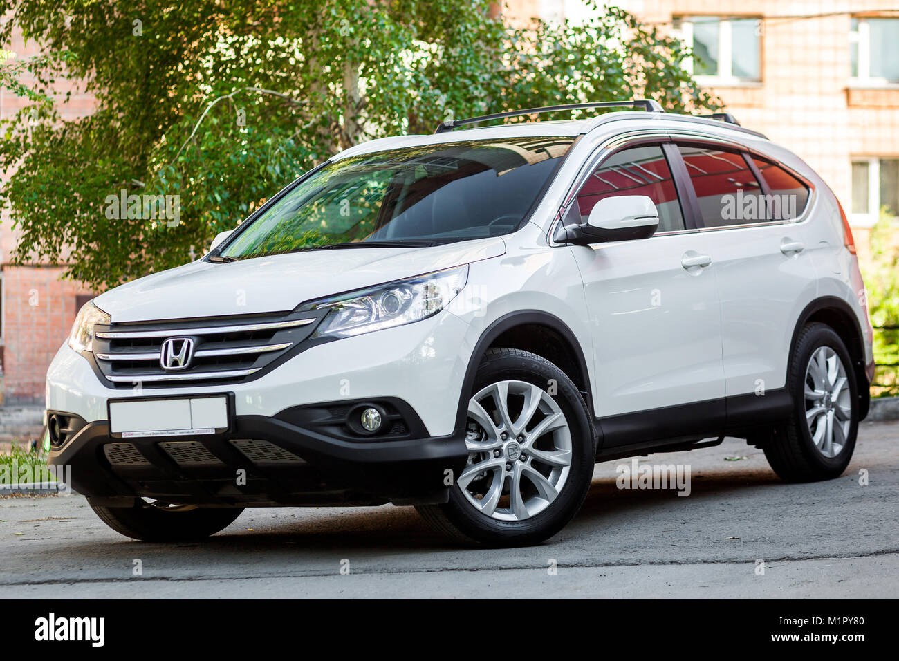 Novosibirsk, Russia -  June 18, 2017: white Honda CRV , side view. Photography of a urban crossover in the street - Stock Image