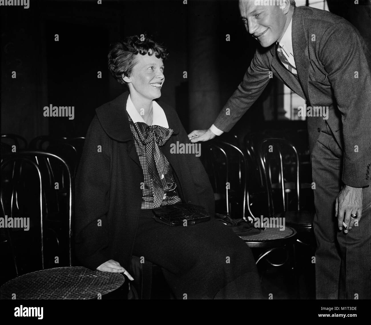 Amelia Earhart (left) Seated Portrait during Senate Hearings on Aviation Safety, Washington DC, USA, Harris & - Stock Image