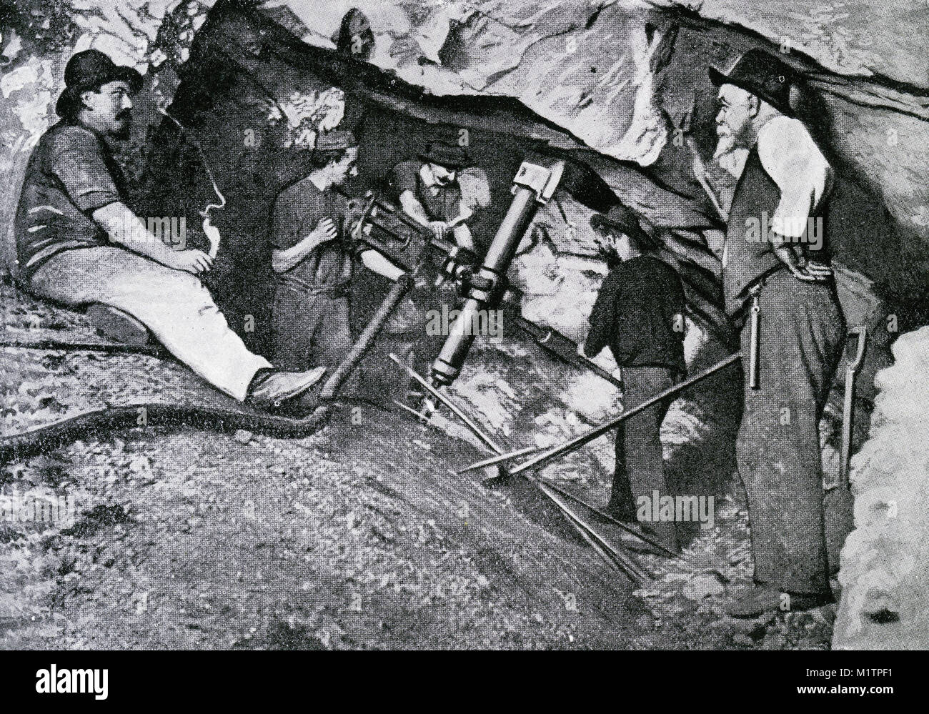 Halftone illustration of gold miners working 4154 feet below the surface in a South African mine, circa 1900. From - Stock Image