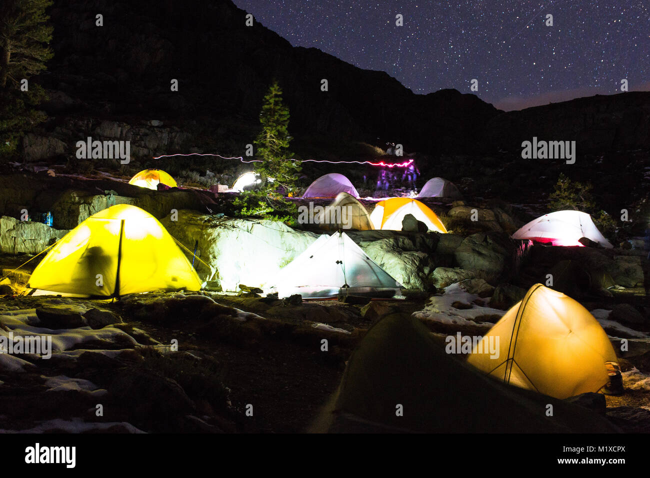 Alamy & Group of tents at night under a starry sky in the Sierra Nevada ...