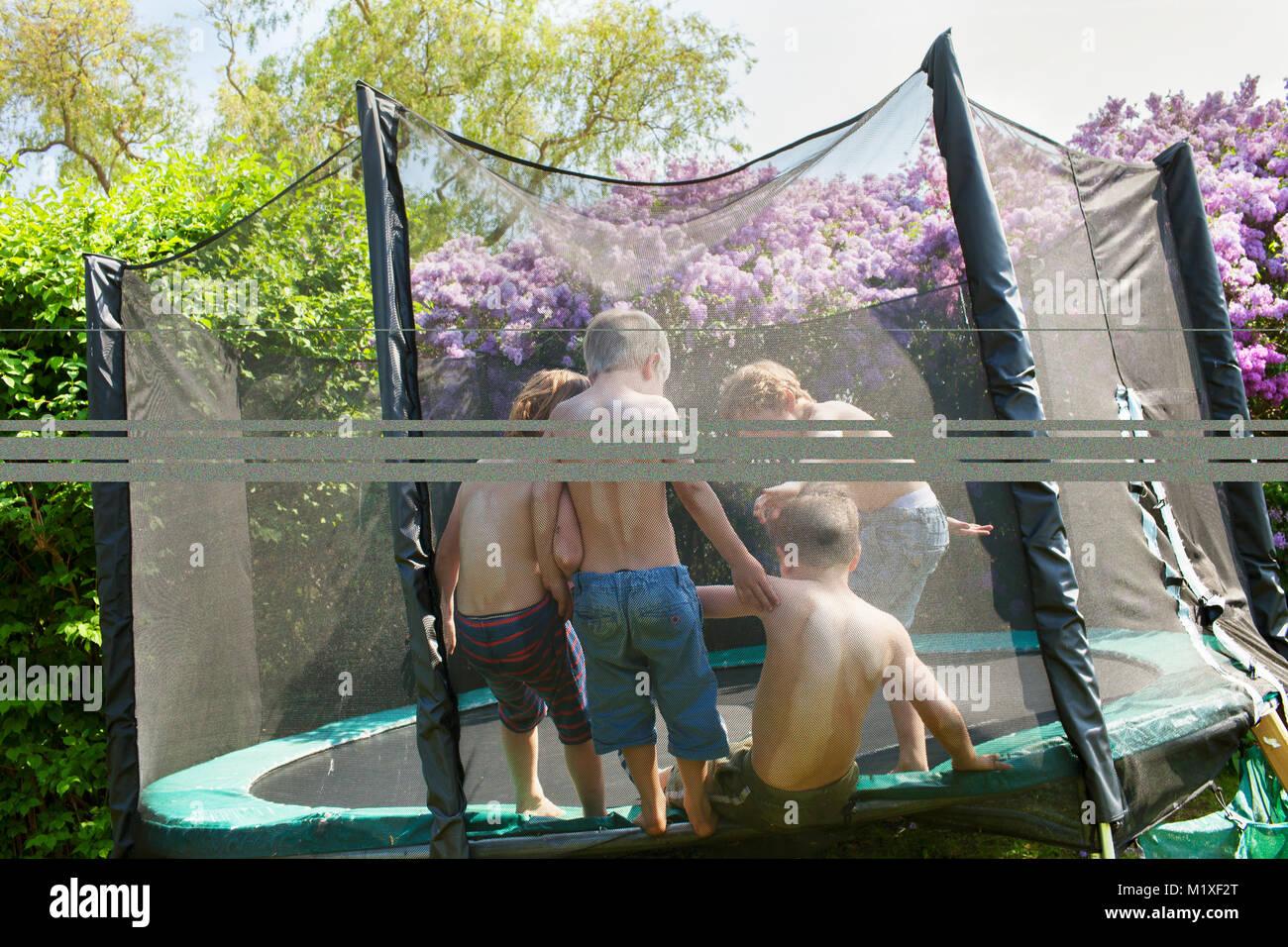 Boys on trampoline - Stock Image