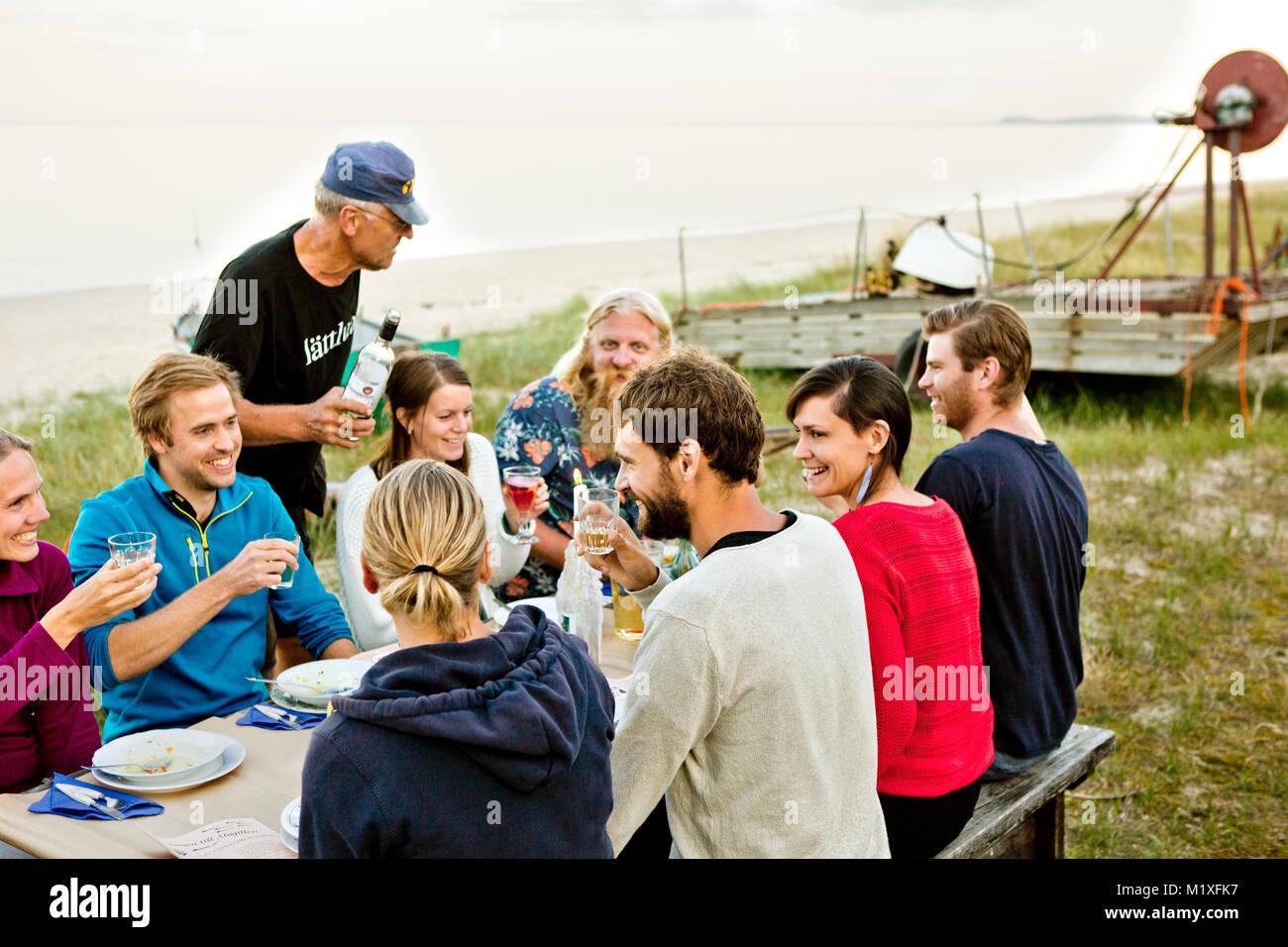 Family eating together in Friseboda, Sweden - Stock Image