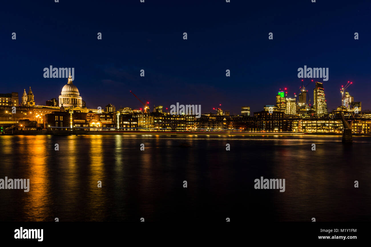 St Paul's Cathedral overlooking the River Thames at night, Bankside, London, UK - Stock Image