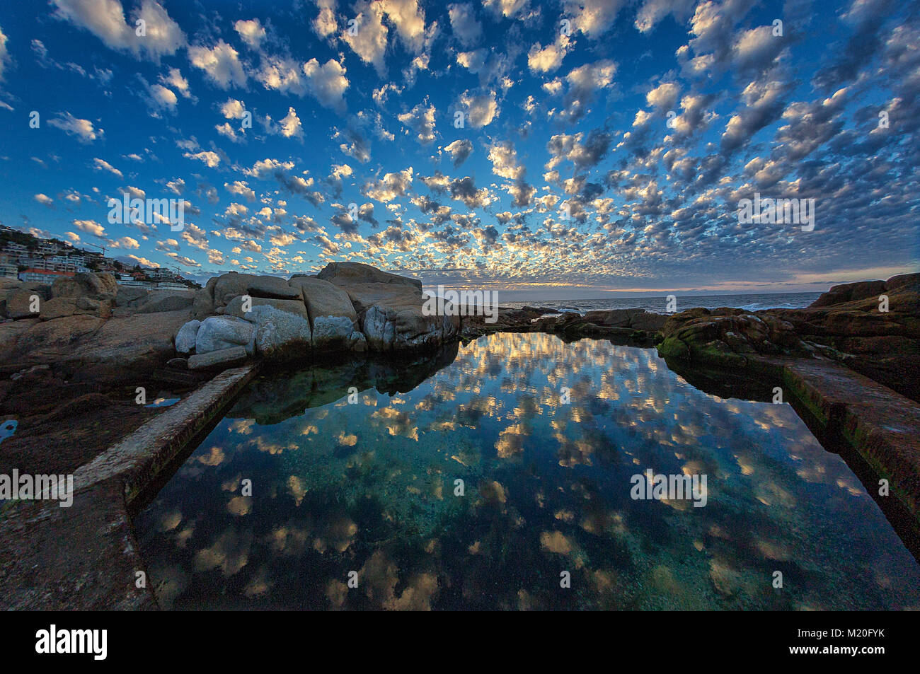 A sunset with reflection in Sea Point, Cape Town, South Africa - Stock Image