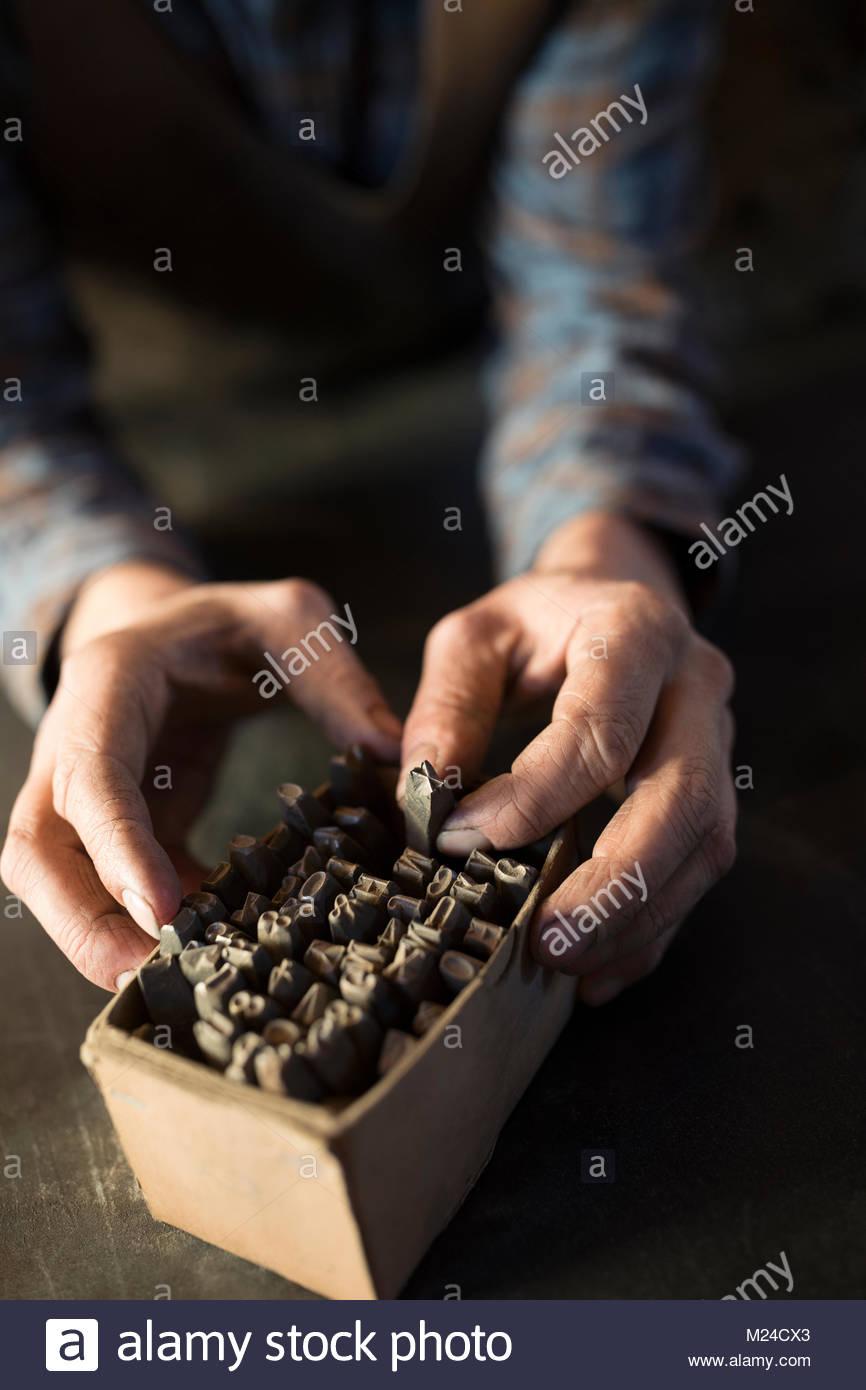 Close up blacksmith selecting tip from box - Stock Image