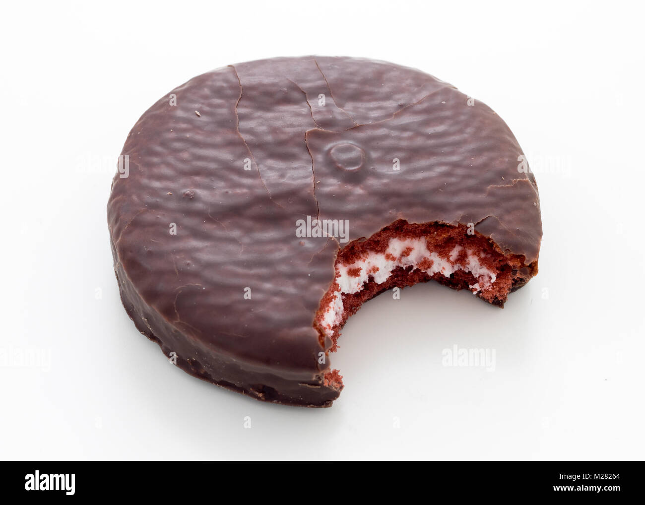 A Jos Louis (Jos. Louis) cake, a confection consisting of two red velvet cake rounds with a cream filling within - Stock Image