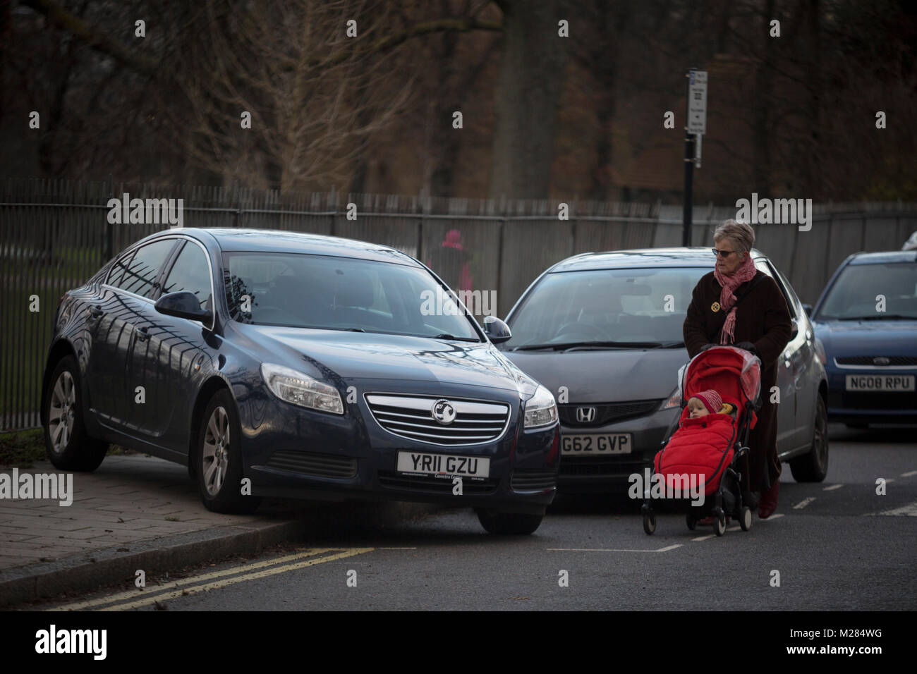 an-elderly-lady-with-a-childs-buggy-walk