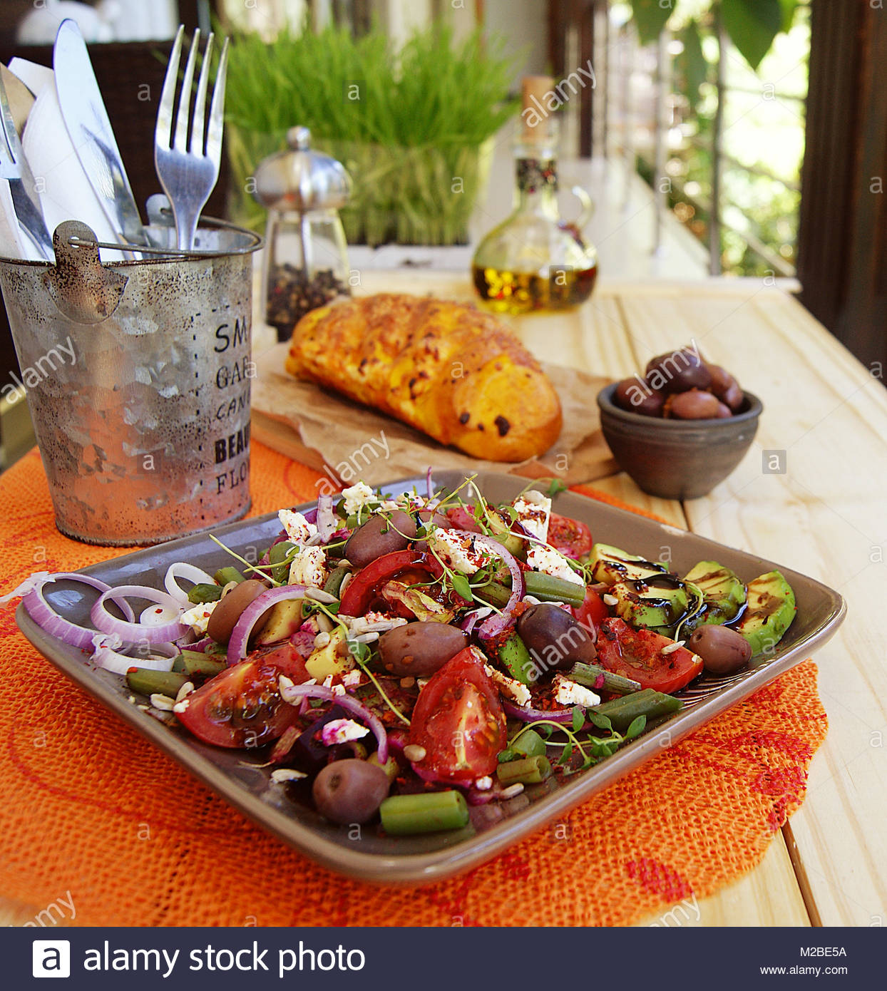 vegetable salad served on a table - Stock Image