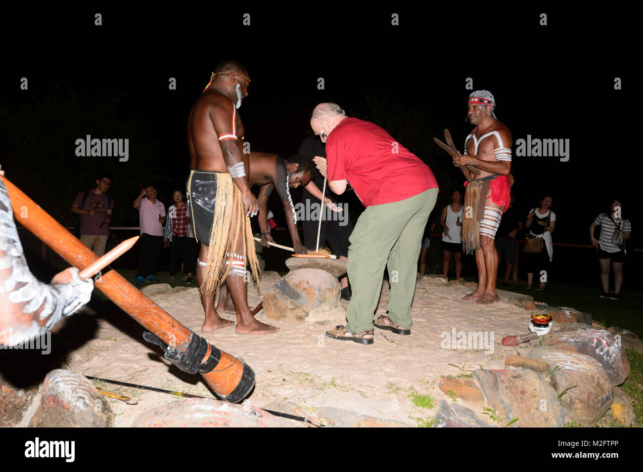 Tourist being shown how to start a fire during a show at Tjapukai Aborignal Cultural Park, Smithfield, Cairns, Far - Stock Image