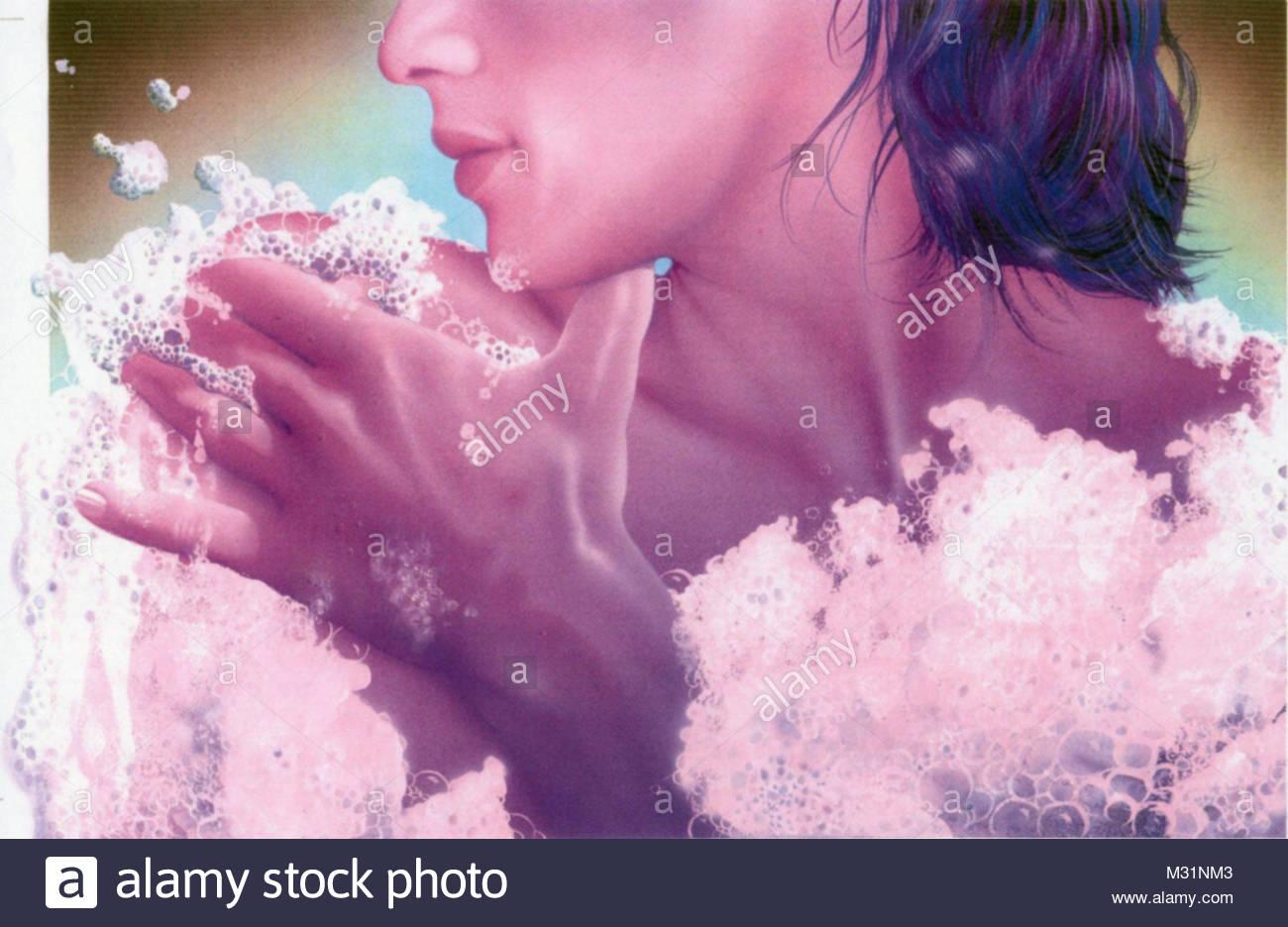 Woman takes bubble bath - Stock Image