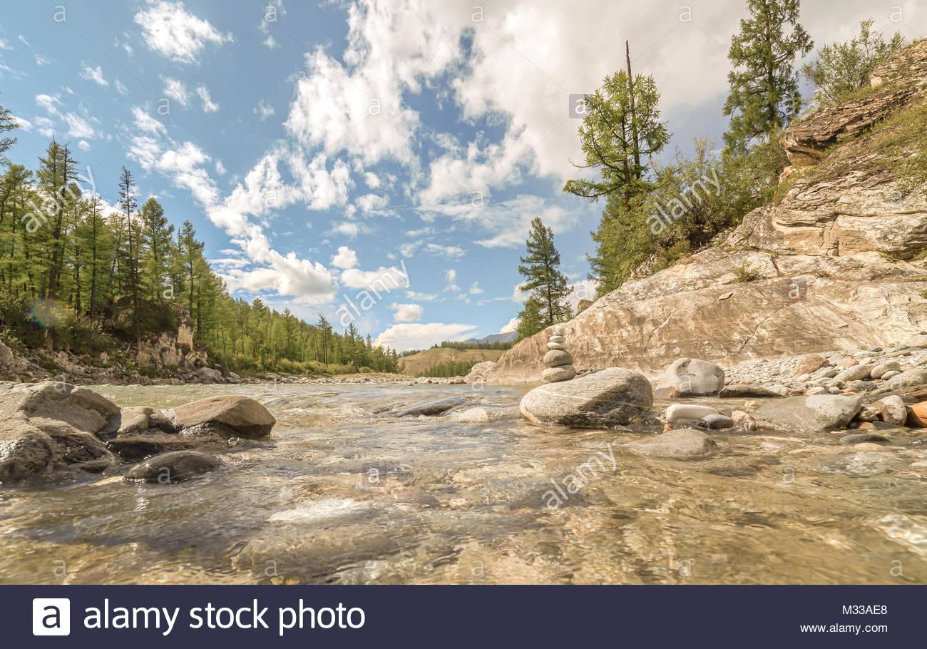 Stony river bank - Stock Image