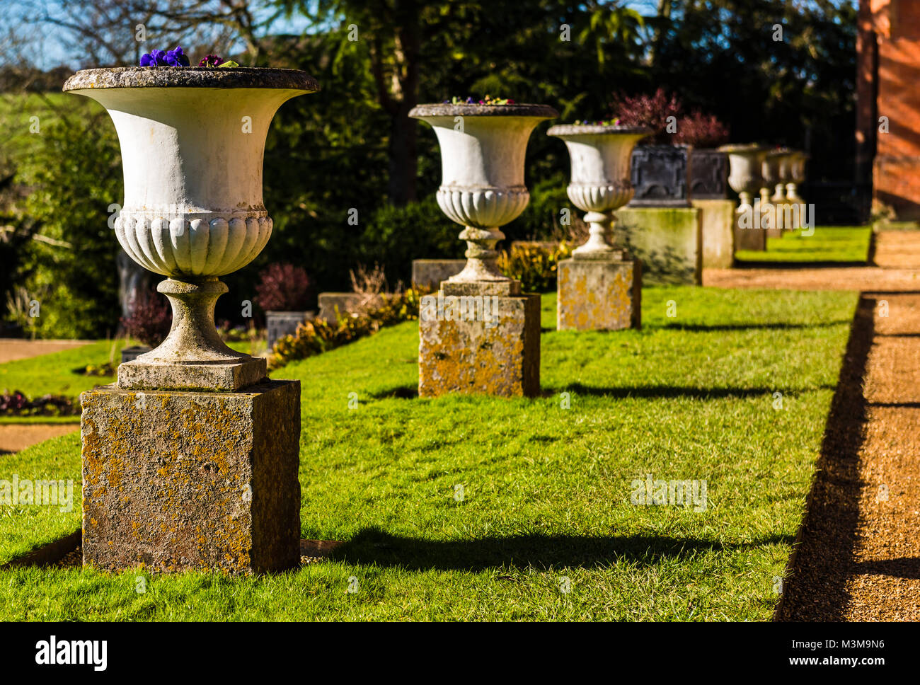 Stone urns in a line at Hughenden, Buckinghamshire, UK - Stock Image