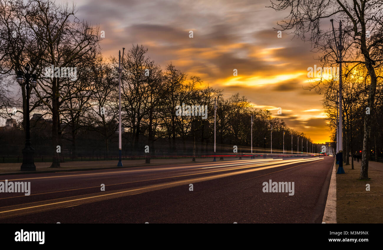 Lights on The Mall at sunset; Buckingham Palace in the background, London, UK - Stock Image