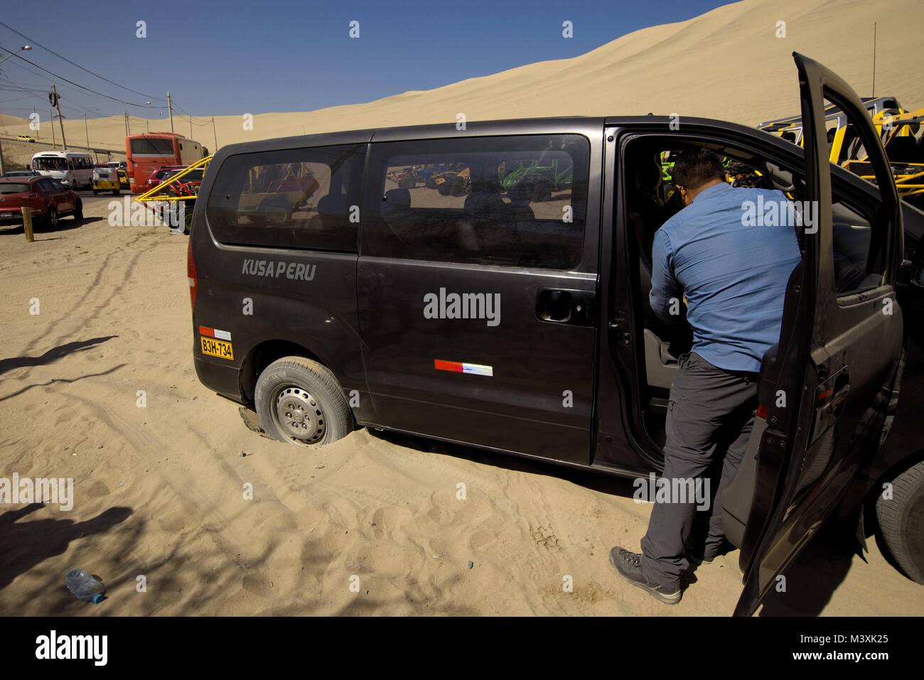 Minivan stuck in the sand, Ica Desert Peru - Stock Image