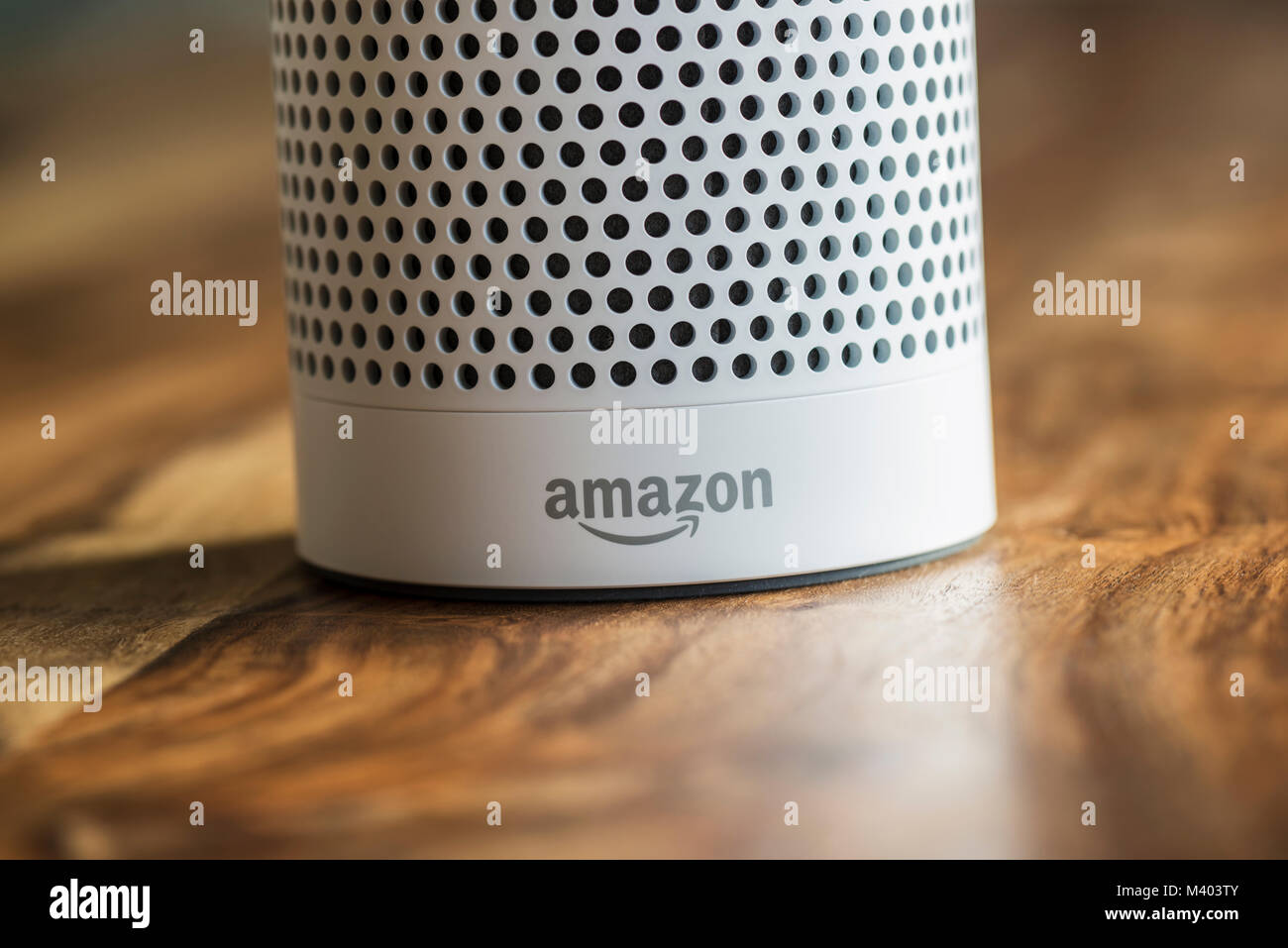 MUENSTER - JANUARY 27, 2018: White Amazon Echo Plus, Alexa Voice Service activated recognition system photographed Stock Photo