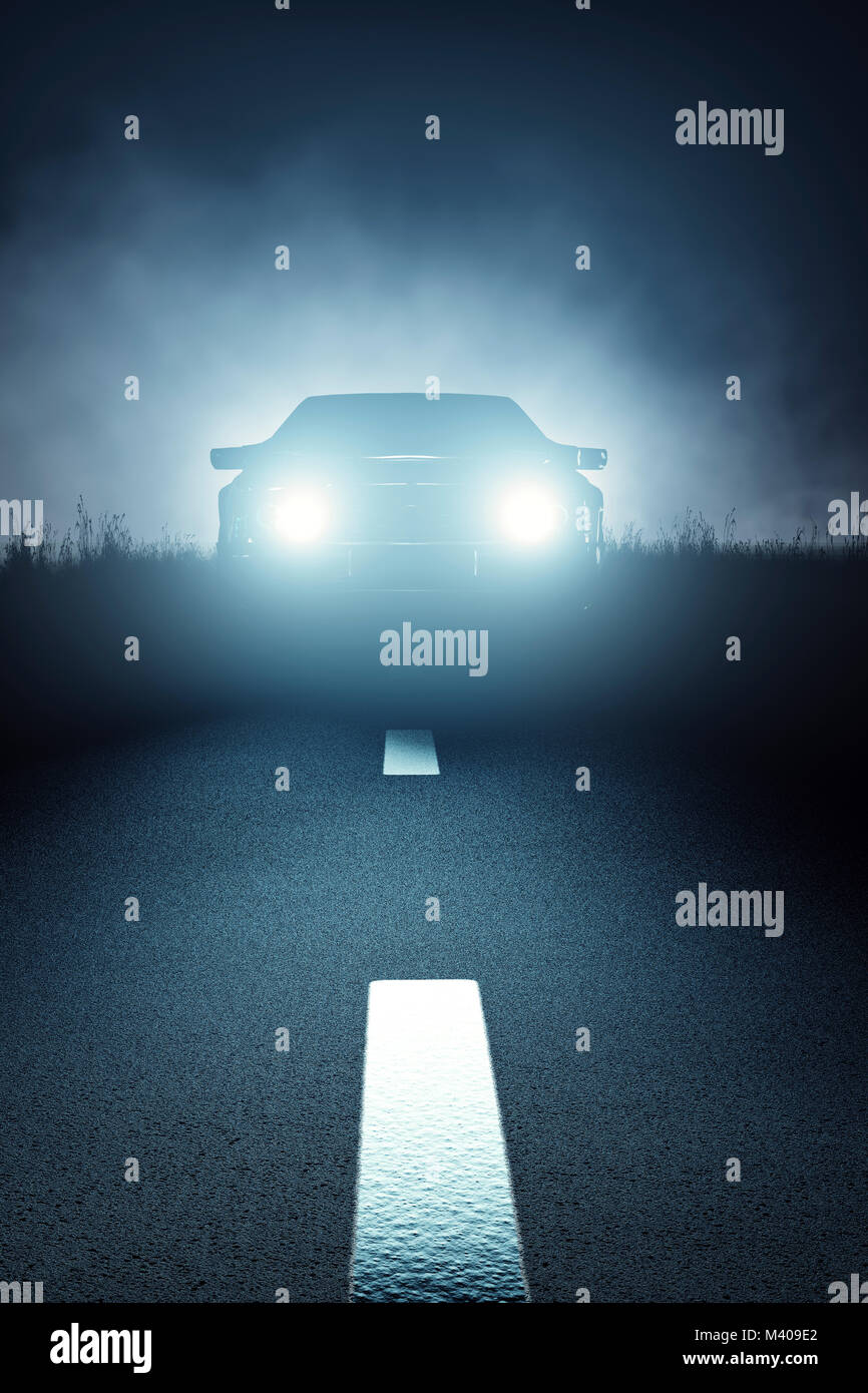 Car lights seen from the front on a dark eerie misty night and approaching on a striped asphalt road (3D render) - Stock Image