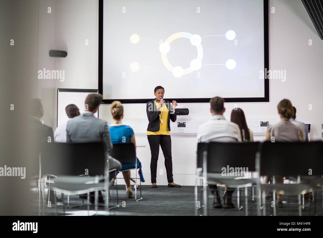Female Executive Leading A Training Conference Stock Photo