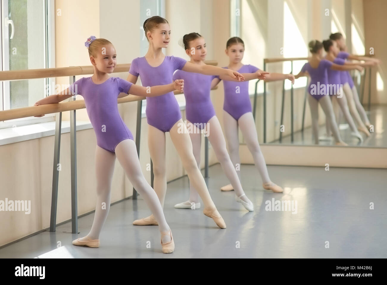da5f8d1dddbf Young ballerinas having rehearsal at ballet school. Pretty young ...