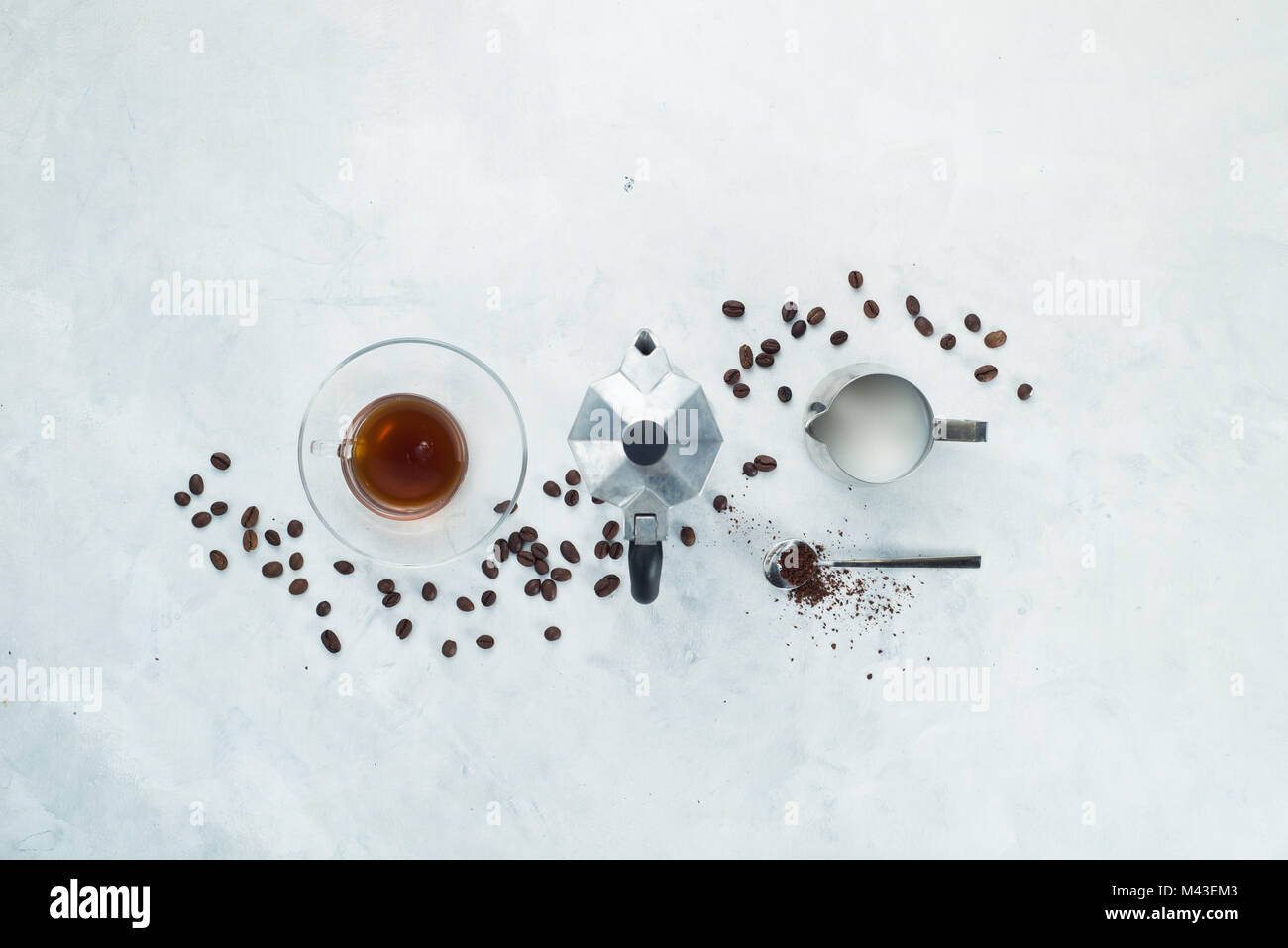 Header with coffee maker minimalist flat lay with coffee beans, milk, ground coffee and geyser coffee maker. Alternative - Stock Image