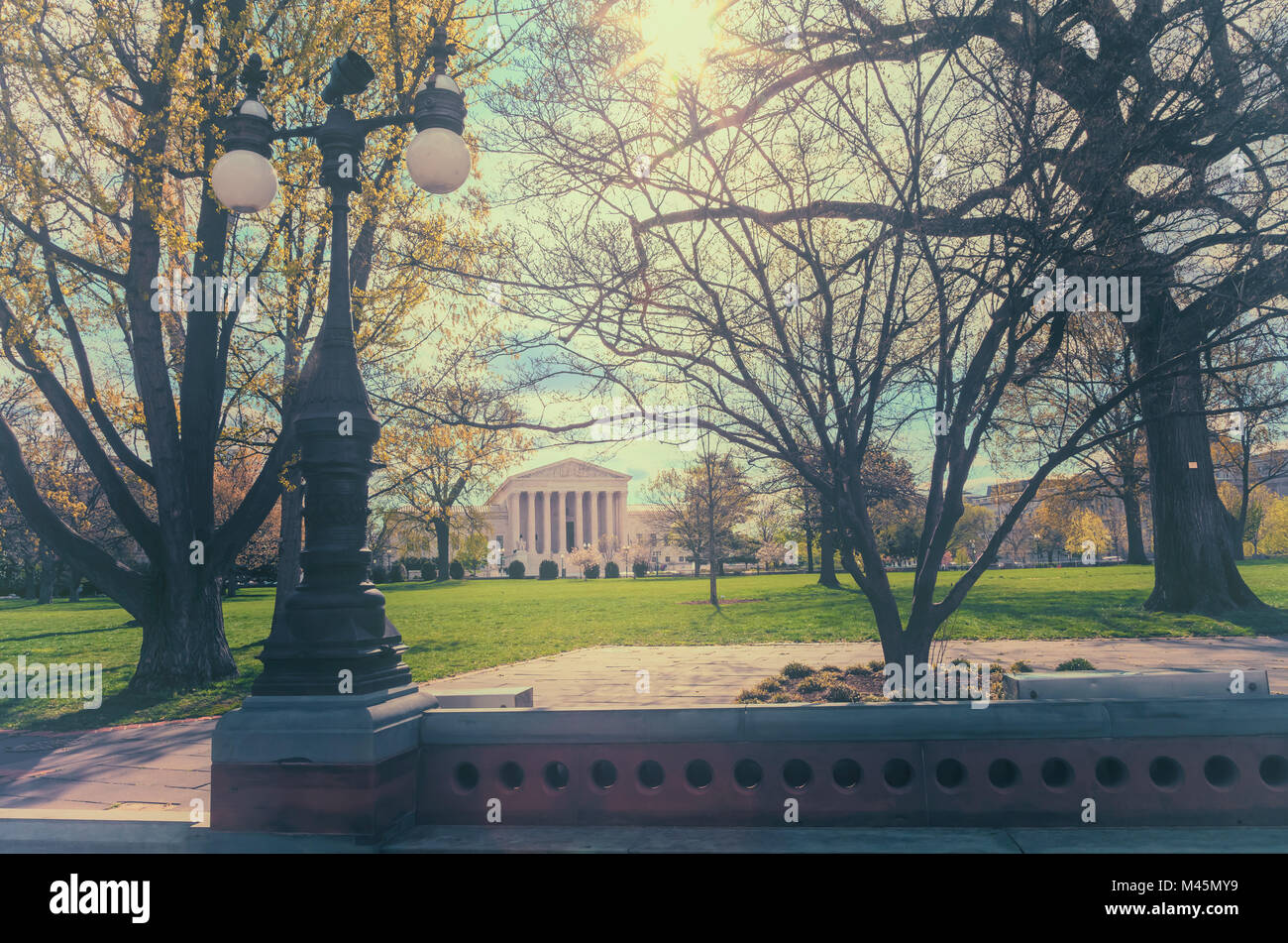 The United States Supreme Court building seen through the city park, Washington, District of Columbia. - Stock Image