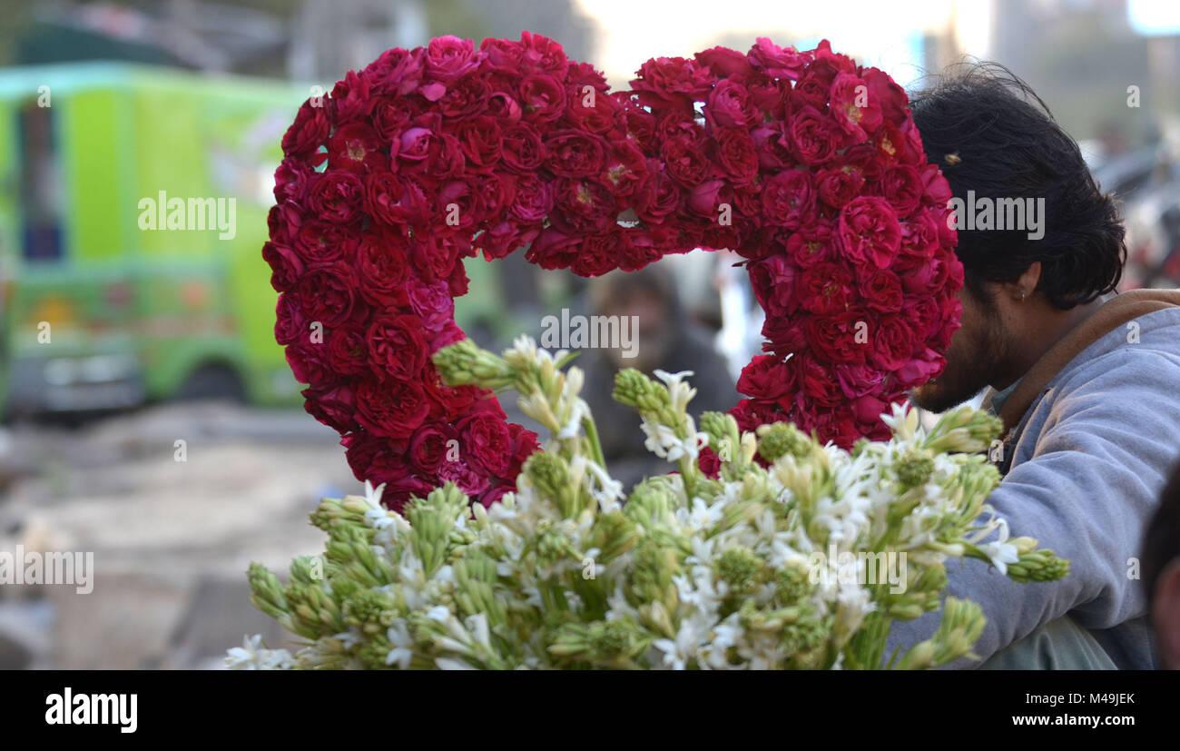 Pakistani people purchasing fresh roses flowers bouquets and pakistani people purchasing fresh roses flowers bouquets and garlands m49jekg izmirmasajfo Images
